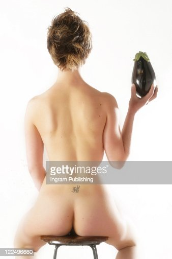 A young female model holding eggplant. . : 스톡 사진