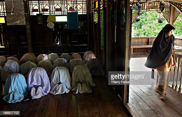 BAN SUNGAIPANAE PATTANI THAILAND Young female Muslim orphans praying at the Centre for Needy Orphans and Poor Children Some of them are victims of...