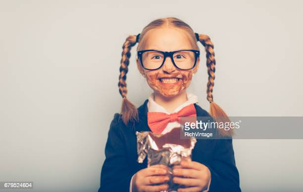 Young Female Nerd Eating Chocolate Bar