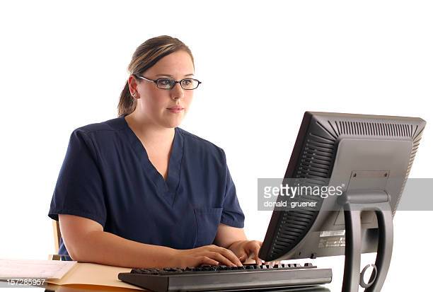 Young Female Nurse Working on Computer Workstation