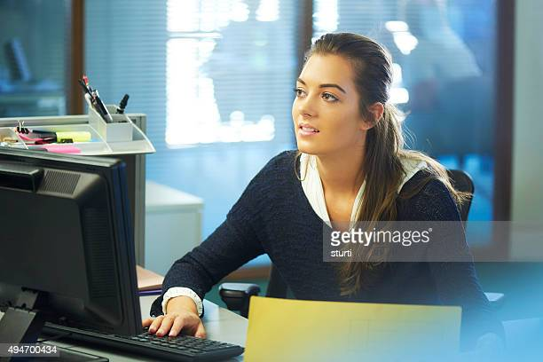 young female office worker daydreaming