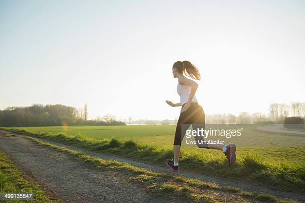 Young female runner on dirt track