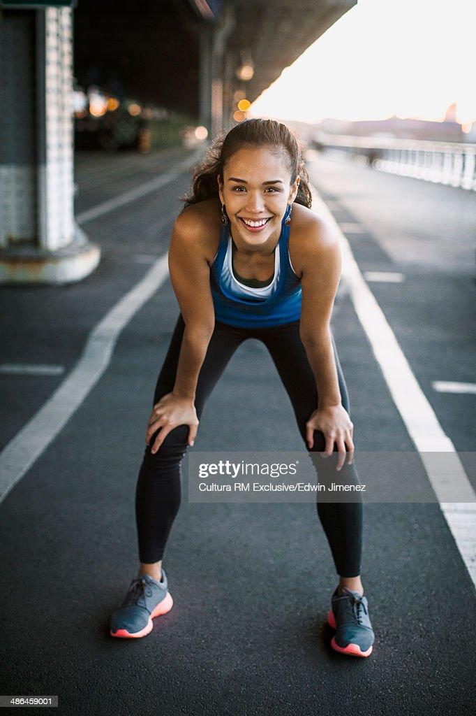 Young female runner taking a break, New York City, USA