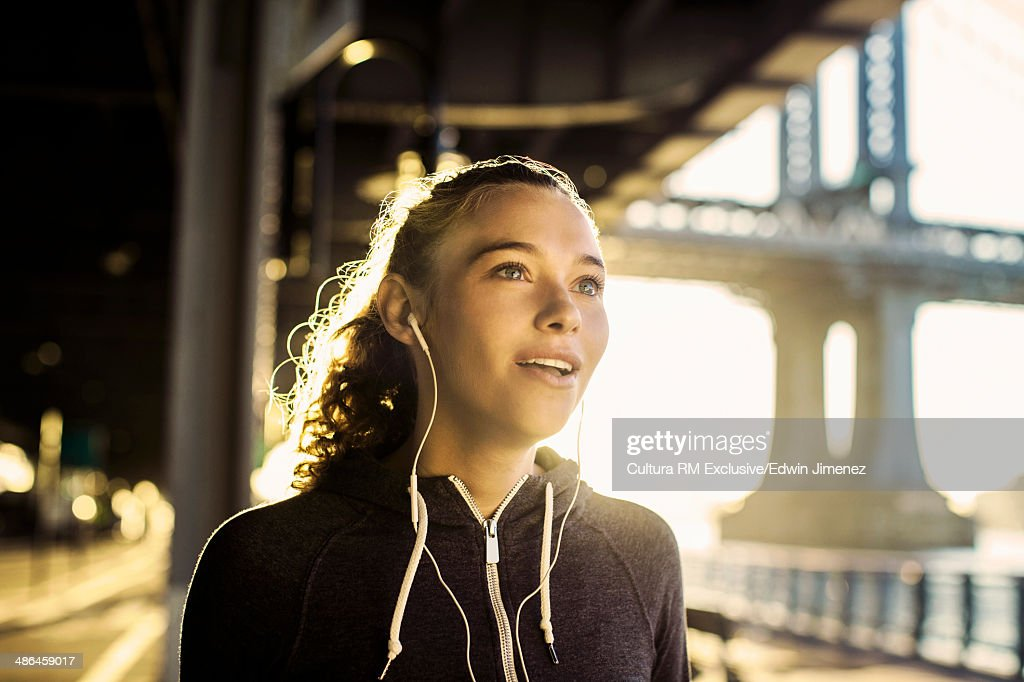 Young female runner watching from waterfront, New York City, USA : Stock Photo
