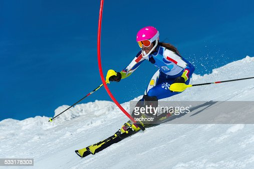 Young female slalom skier during the race