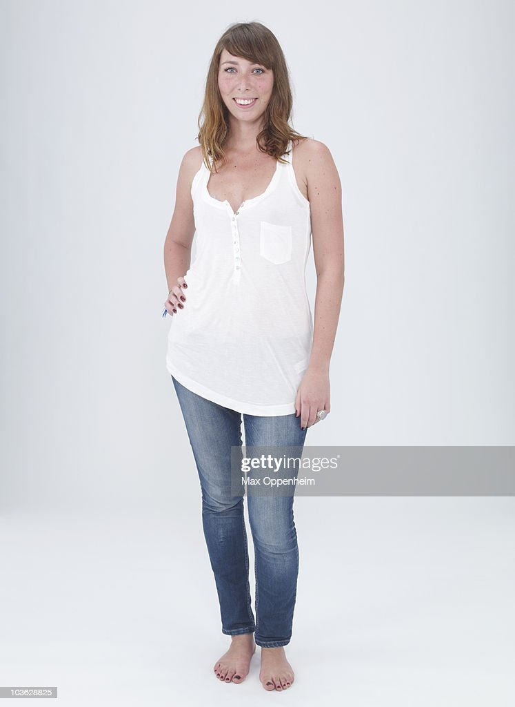 young female smiling with hand on hip : Stock Photo