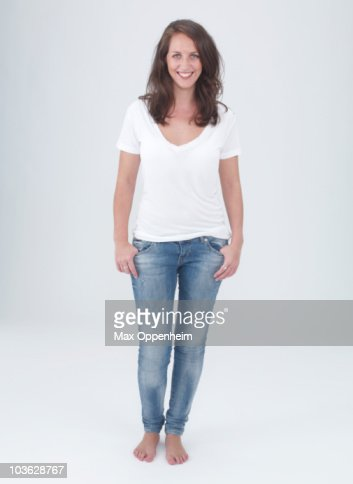 young female smiling with hands in pockets