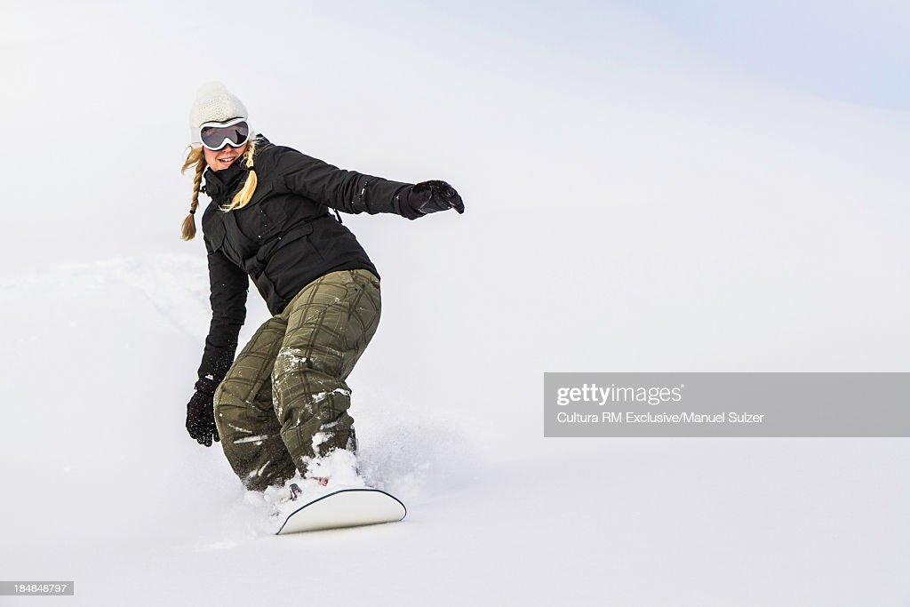 Young female snowboarding, Reutte, Tyrol, Austria
