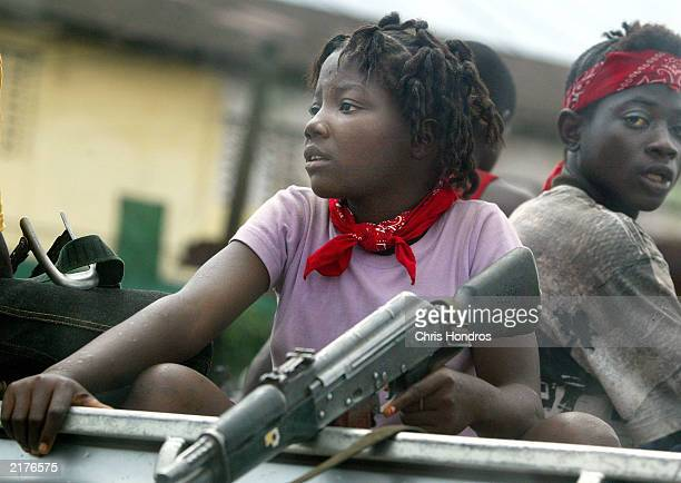 A young female soldier sits in a truck just prior to a rebel attack July 19 2003 near front line positions just outside Monrovia Liberia In an...
