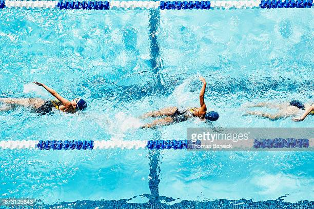 Young female swimmers practicing in outdoor pool