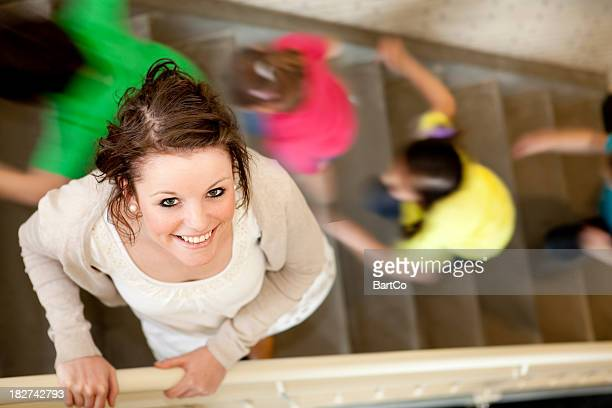 young female teacher on the stairs