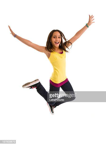 Young female teenager jumping mid air gesturing with outstretched arms