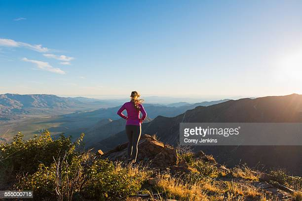 Young female trail runner looking at view on Pacific Crest Trail, Pine Valley, California, USA