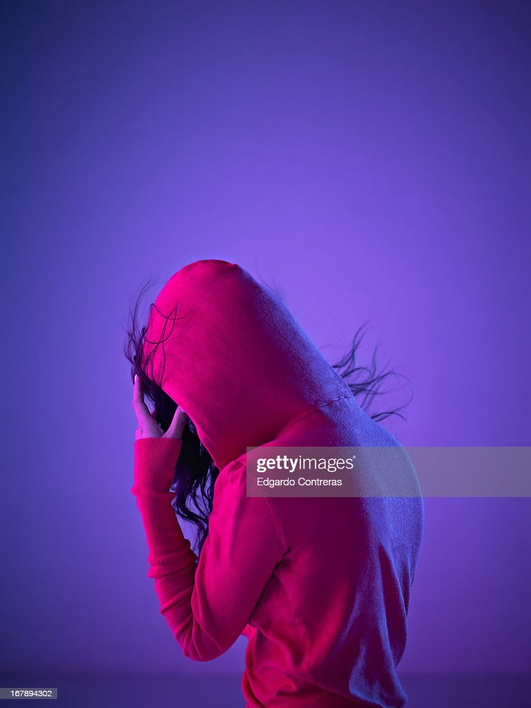 young female wearing a pink hood : Stock Photo