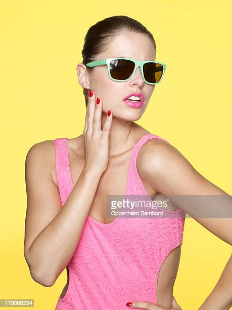 young female wearing sun glasses and posing