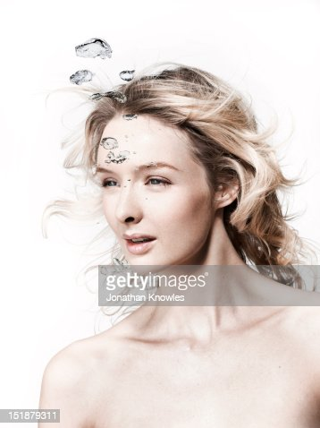 Young female with water bubbles : Stock Photo