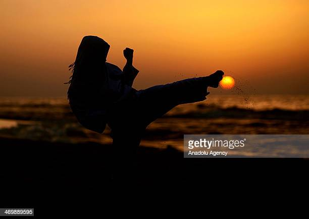 Young females in Gaza working hard to specialize in Karate practising on Gaza beach February 17 2014