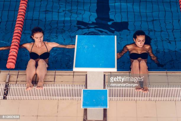 Young Females Resting After Swimming at Indoor Swimming Pool