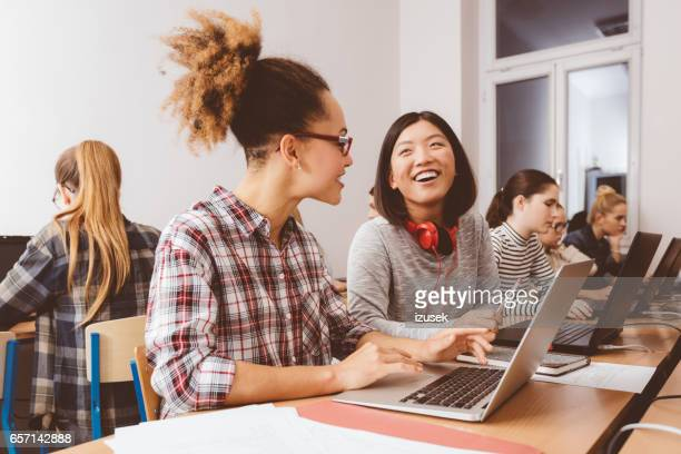 Young females students learning computer programming