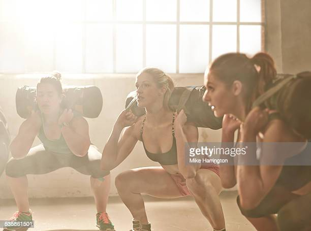 Young females using weighted fitness bag
