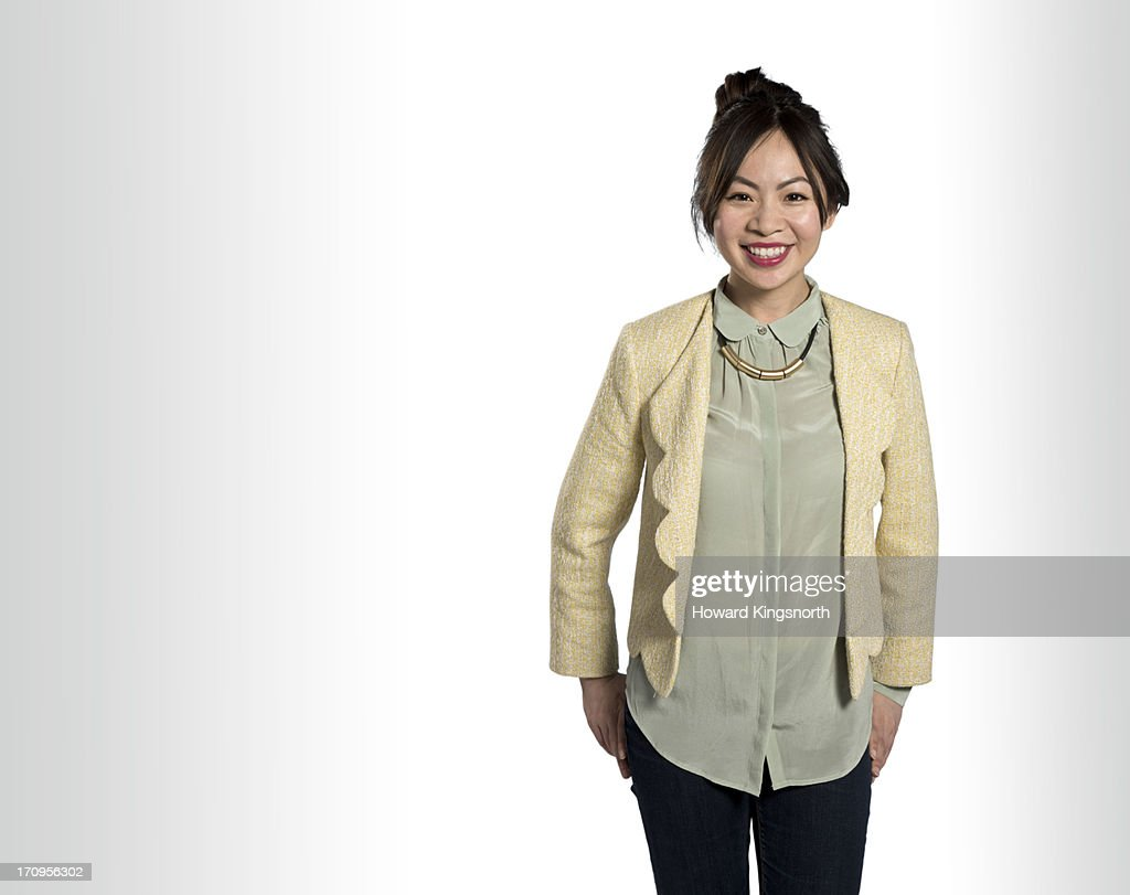 young female,standing and smiling to camera : Stock Photo