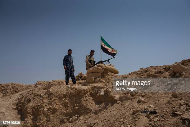 Young fighters from Quwat Al Nukhba set up position on their forwarding bunker towards Islamic State positions in Al Shaddadi on the Deir Ez Zor...