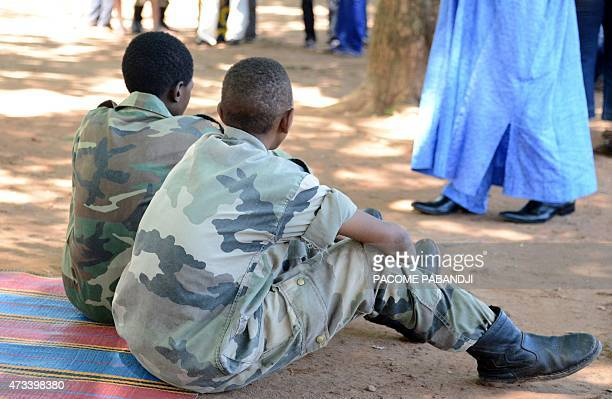 Young fighters sit on a blanket in downtown Bambari after over 350 Central African Republic's child soldiers were released by armed groups honouring...