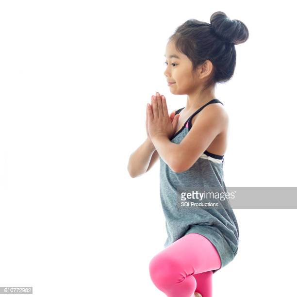Young Filipino girl doing yoga pose