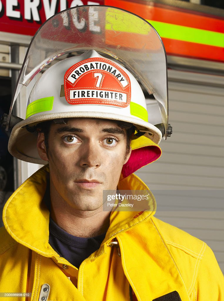 Young fireman, portrait : Stock Photo