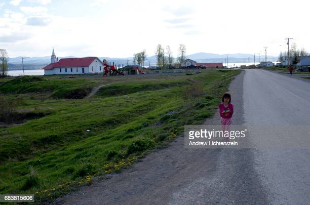 Young First Nation walks down a street on April 25 2016 in the small community of Taiche British Columbia Three years after 26 year old Mackie Basil...