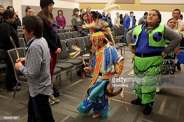 Young First Nations dancers perform during the Idle No More Youth Forum in Ottawa Ontario Canada on Friday Jan 25 2013 All nations creeds and genders...