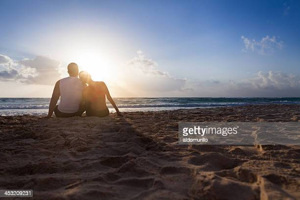 Young fit couple watching the sunrise