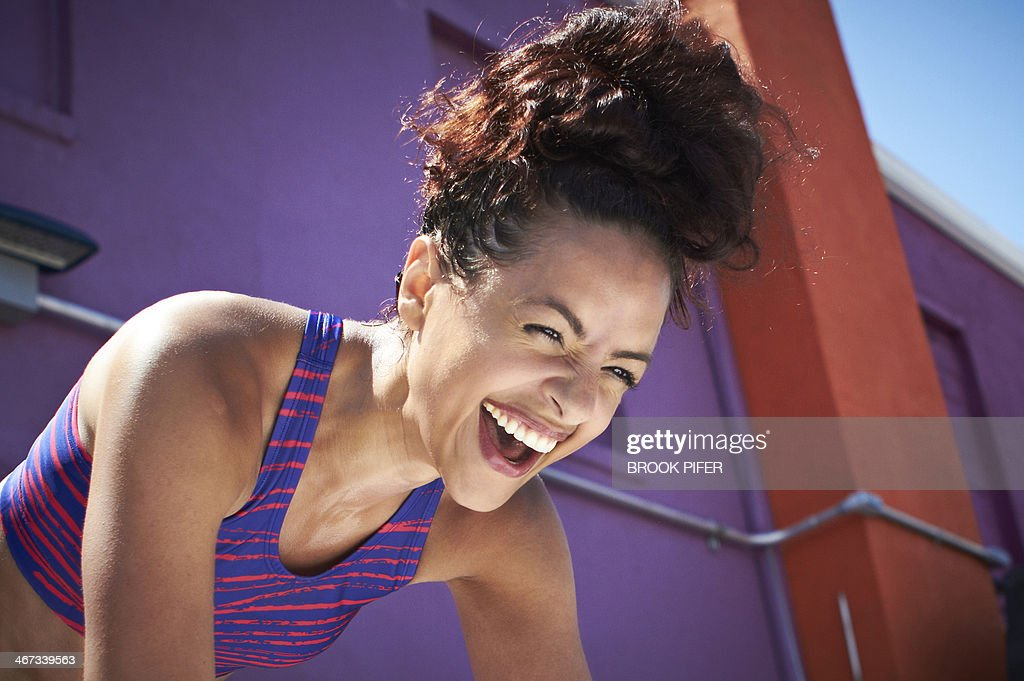 Young fit woman laughing : Stock Photo