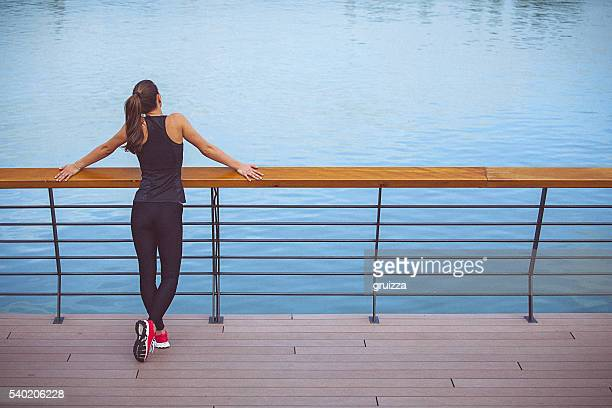 Young fit woman relaxing after running