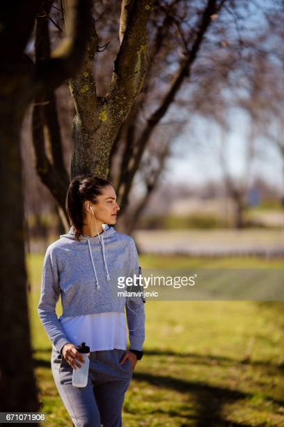 Young fitness girl resting in nature