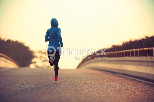 young fitness woman trail runner running  on city road : Stock Photo