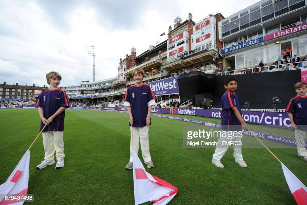 Young flag bearers wait for the players to make their way onto the pitch