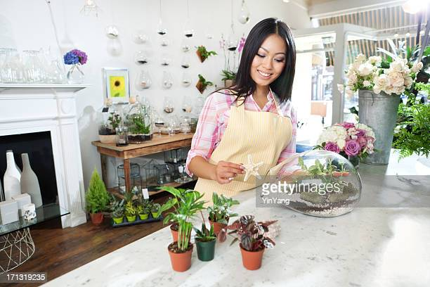 Young Florist Working on Terrarium in Her Retail FLower Shop