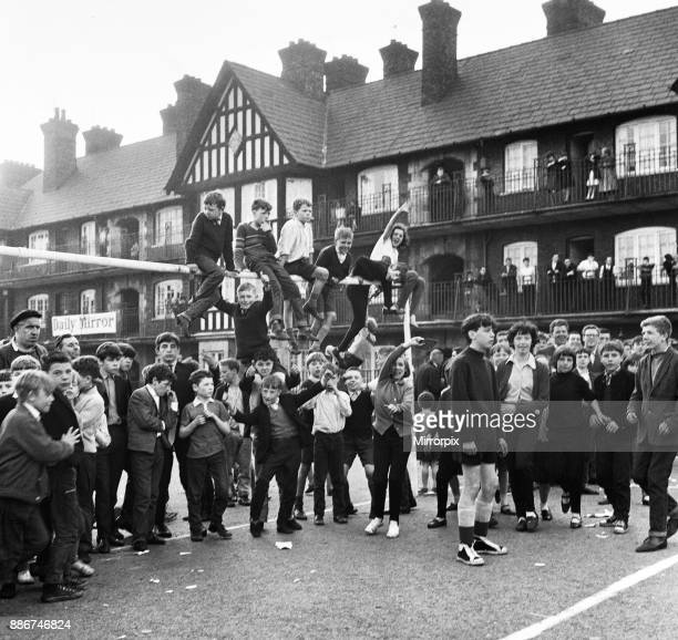 Young football fans sits on top of the crossbar following the conclusion of the Eldon Grove Cup Final in Liverpool The competition is held to prove...