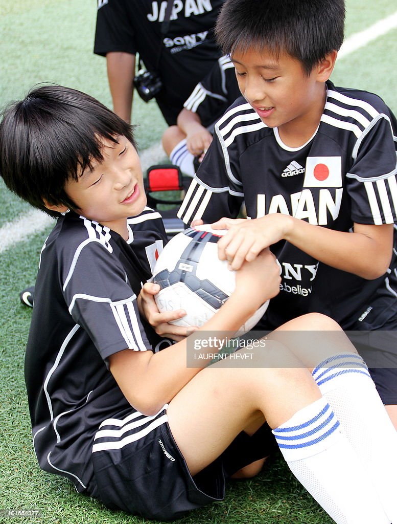 Young football players represinting Japan take part in the Mini World Cup 2010 in Hong Kong on June 6, 2010. The South Africa 2010 World Cup will start on June 11.