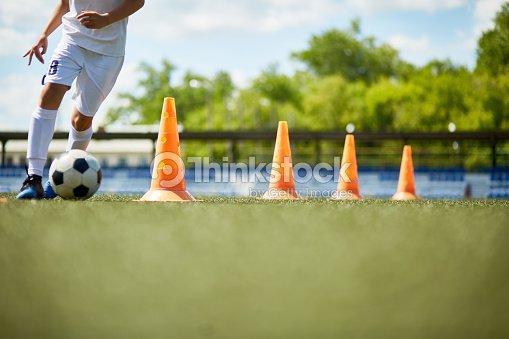 Young Footballer Enjoying Practice : Foto stock