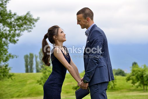 Young Formally Dressed Couple Looking Lovingly At Each Other Stock
