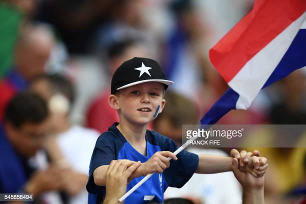 A young France fan waits for the start of the Euro 2016 final football match at the Stade de France in SaintDenis north of Paris on July 10 2016 /...