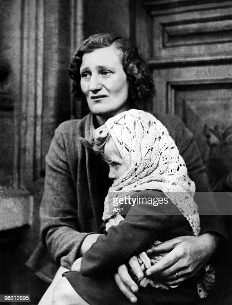 A young French girl clings to her mother in May 1940 as French civilians flee the German Army offensive in the north of France during WWII About 10...