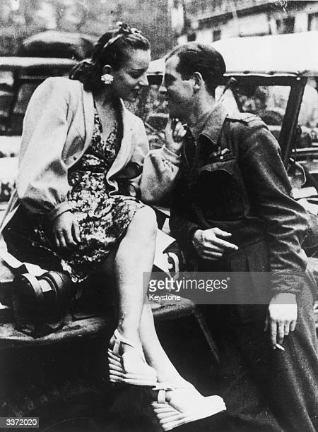 A young French woman makes eyes at an RAF officer after the liberation of Paris during World War II 1944
