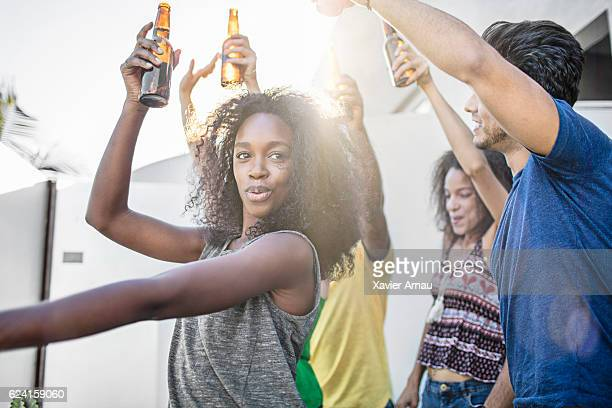 Young friends dancing at rooftop party