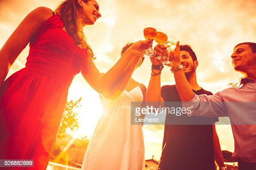 Young friends drinking together