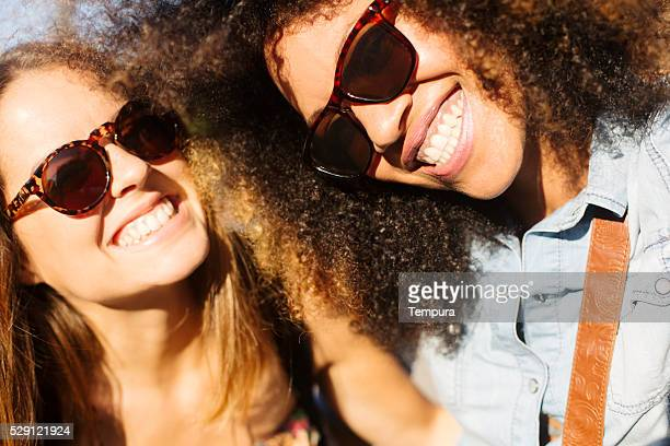 Young friends fooling with smartphone and taking a selfie