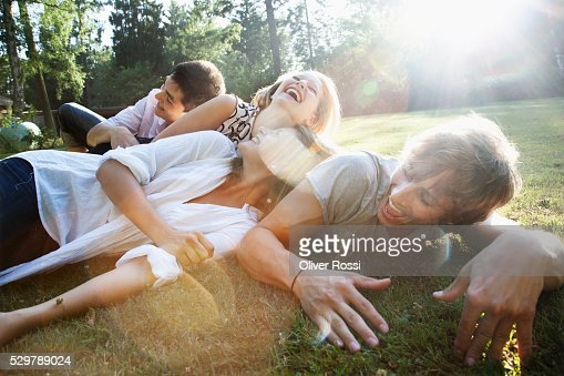 Young friends hanging out in a park : Photo