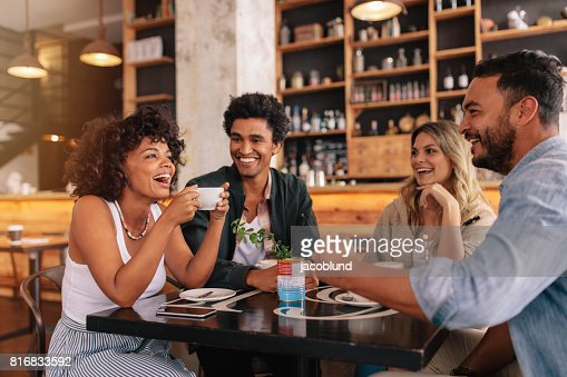 Young friends having a great time in cafe : Stock Photo